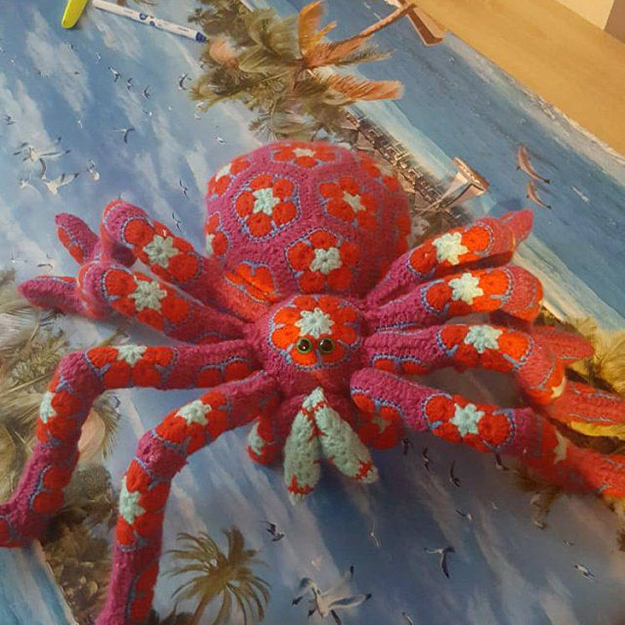 pink spider with orange flowers