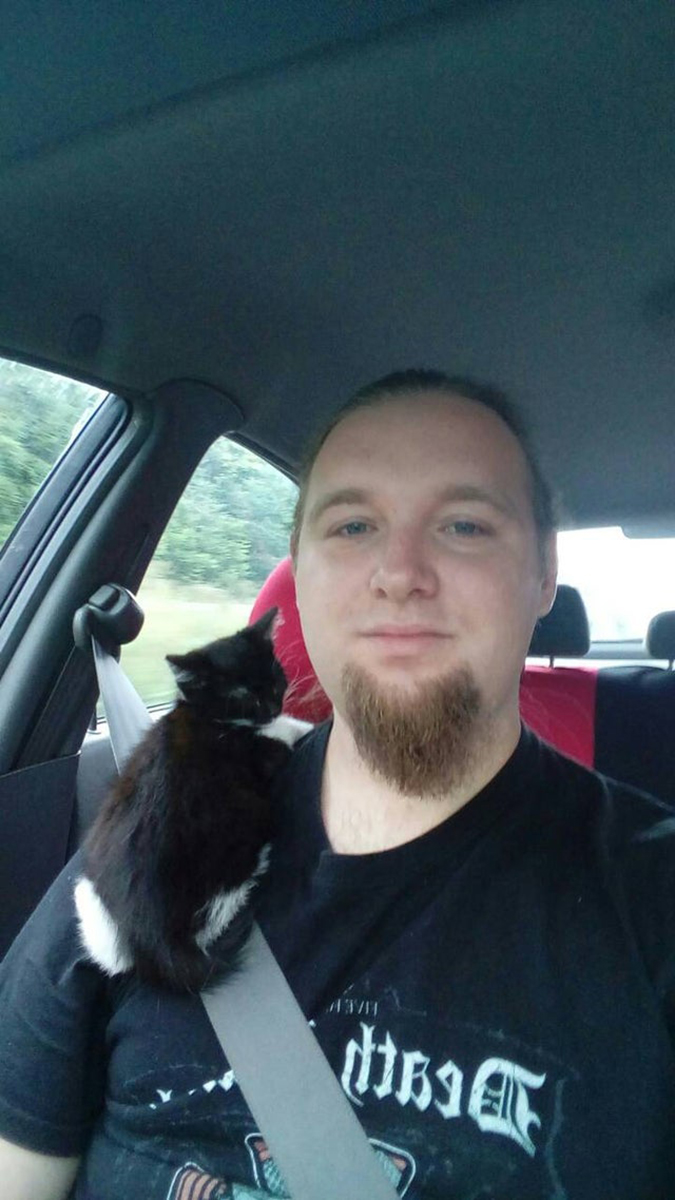 rescue pet photos-kitten rides on her new human's shoulder