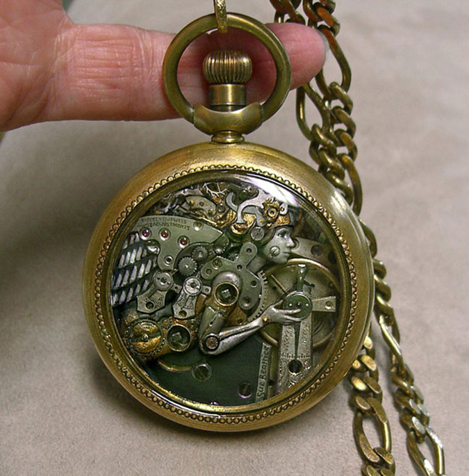 sculpture of a woman inside a pocket watch case