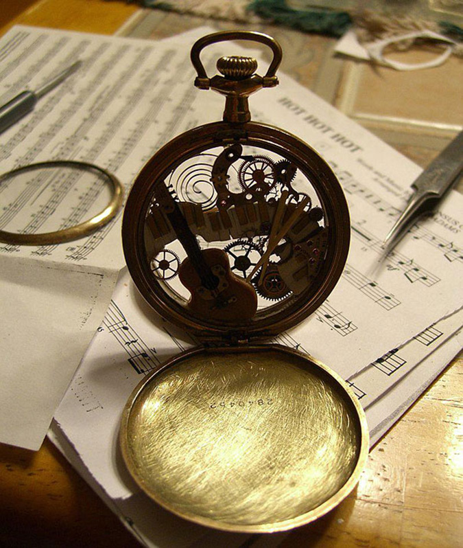 steampunk sculptures musical instruments inside a pocketwatch case