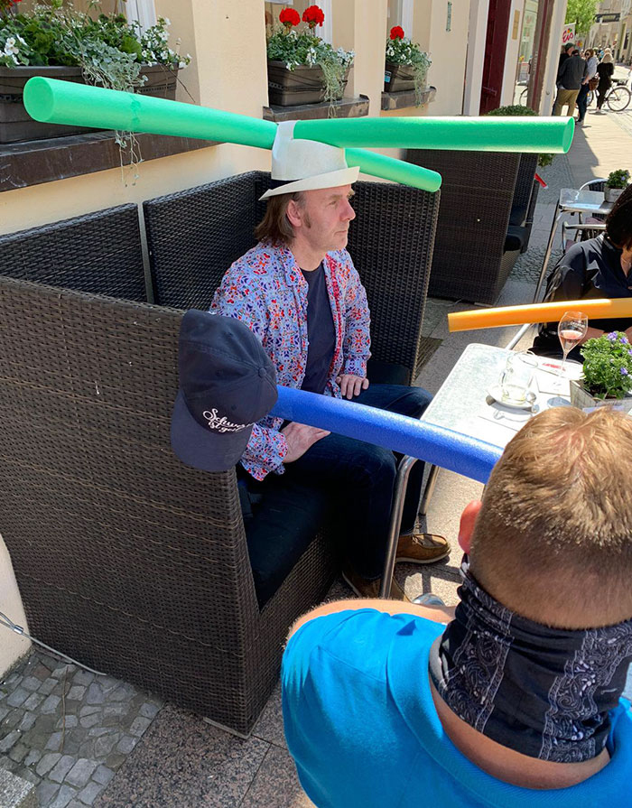 Cafe Customer Wearing Hat with Green Pool Noodle