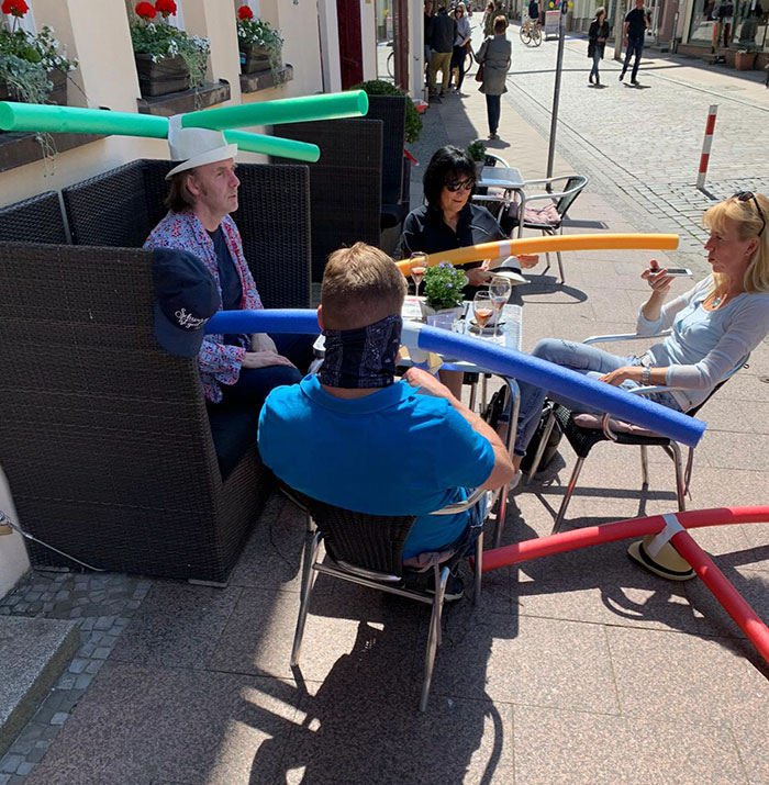 Cafe Customers in Germany Wearing Hats with Pool Noodles