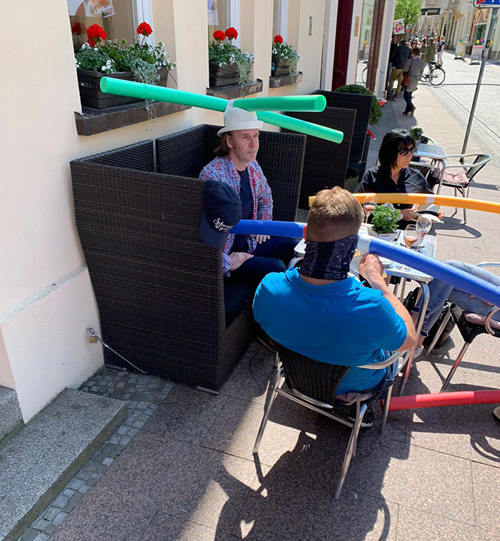 Cafe & Konditorei Rothe Customers Wearing Hats with Pool Noodles