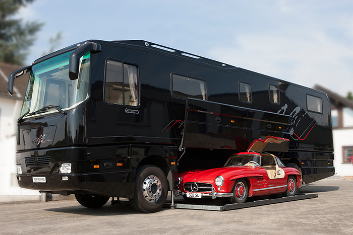 black volkner mobil luxury motorhome with built-in garage