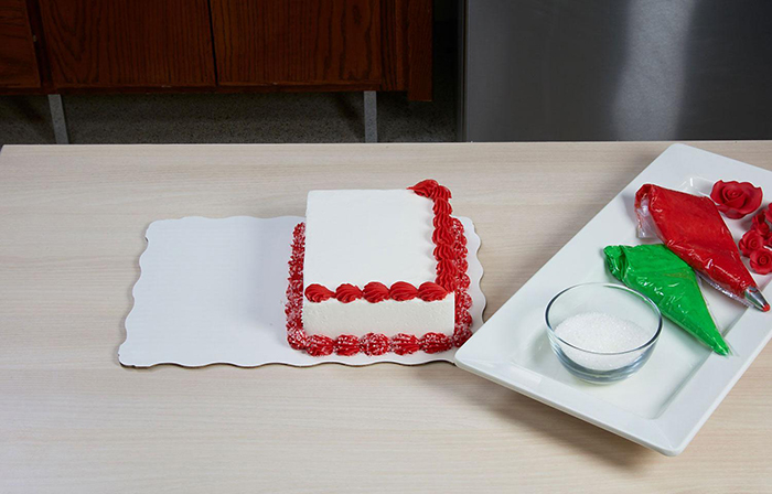 cake in the middle of being decorated