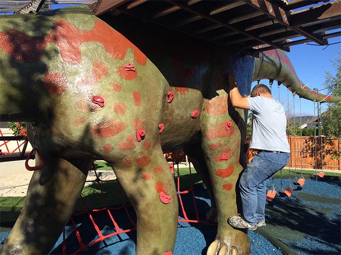 dino statue playground rock climbing handles