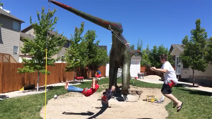 dino statue playground swings on tail