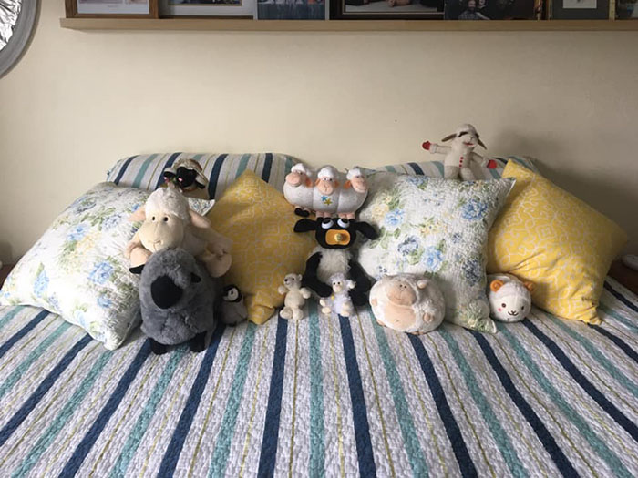 jack makes the bed with plush accessories