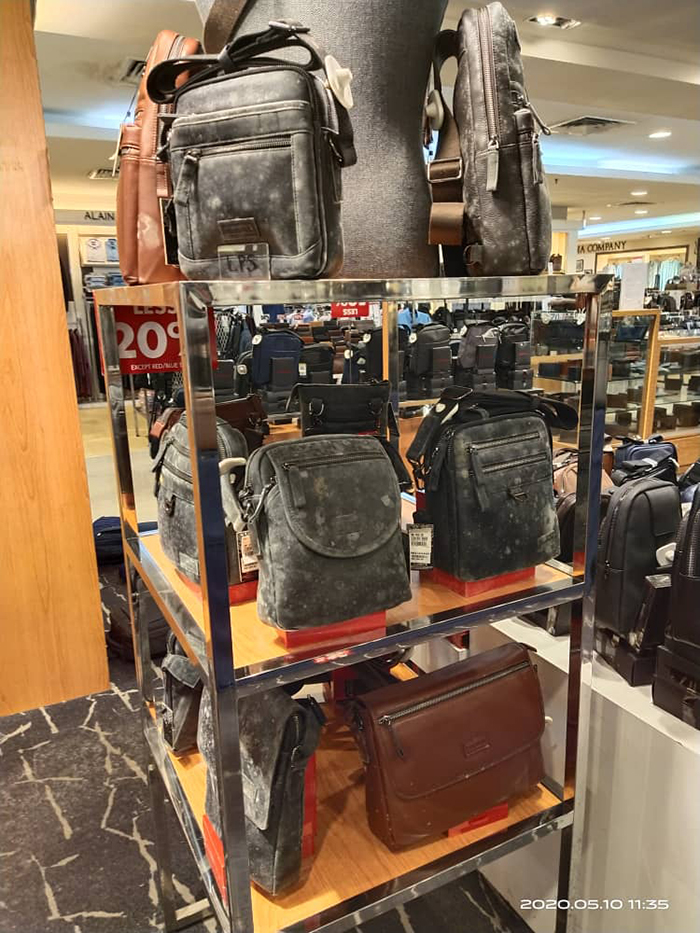 leather bags covered in mold