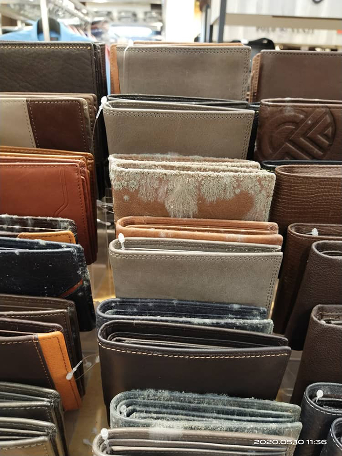 leather wallets covered in mildew