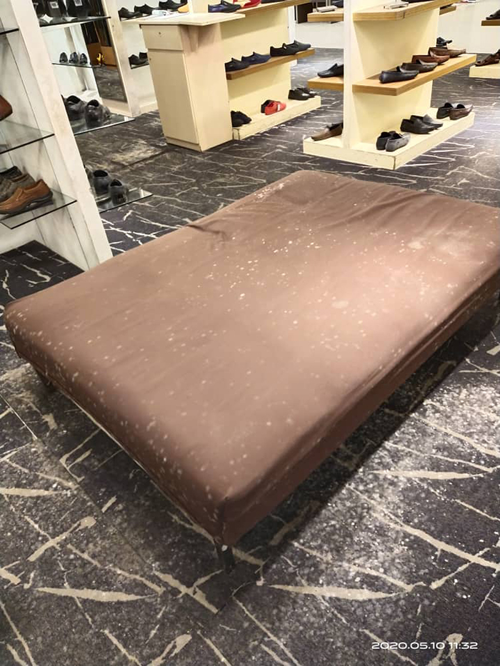 malaysian department store bench covered in mildew
