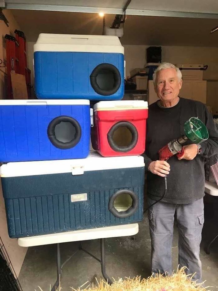 man recycles old coolers into cat shelters