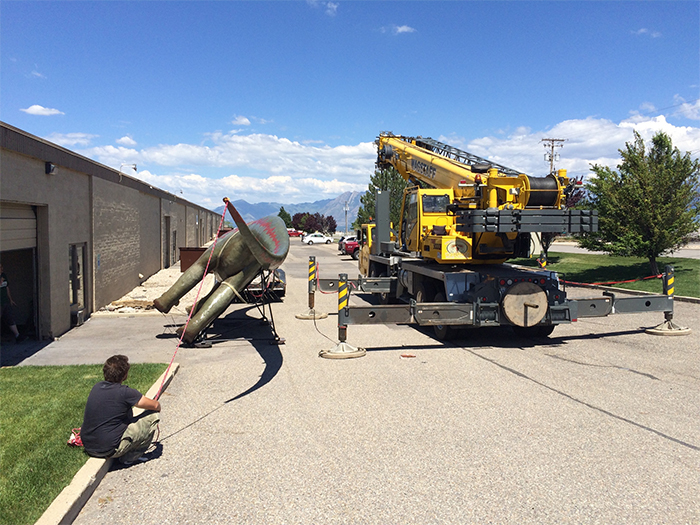matthew cosman hires crane to transport the dino statue