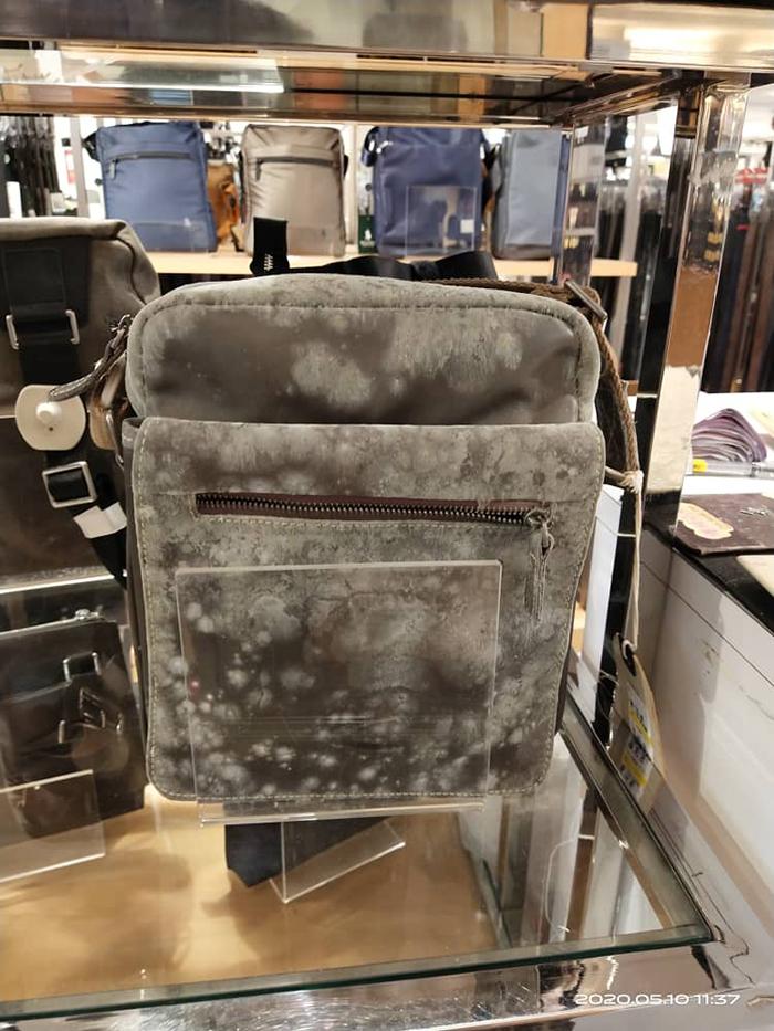moldy leather bag