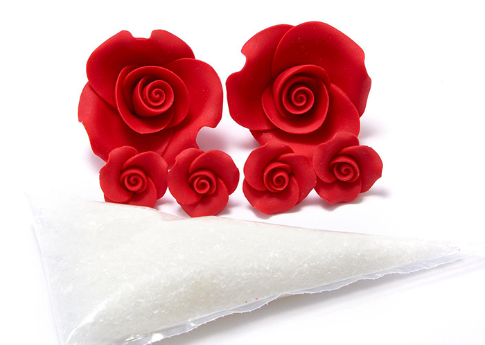 sugar roses and white icing in piping bag