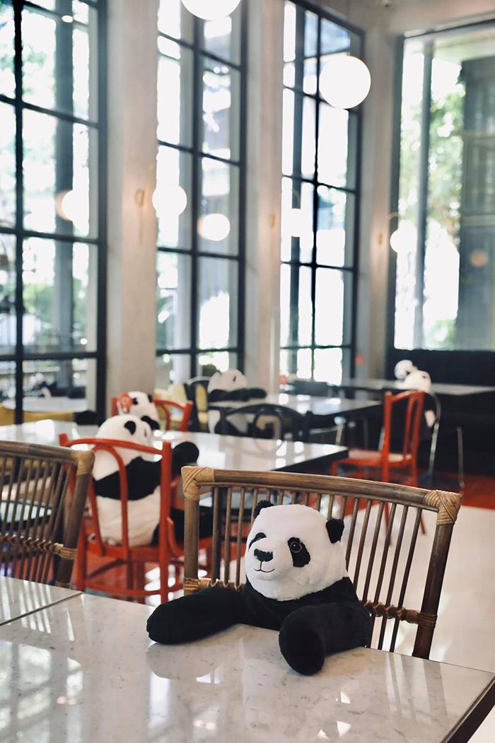 thailand restaurant places plush pandas on seats