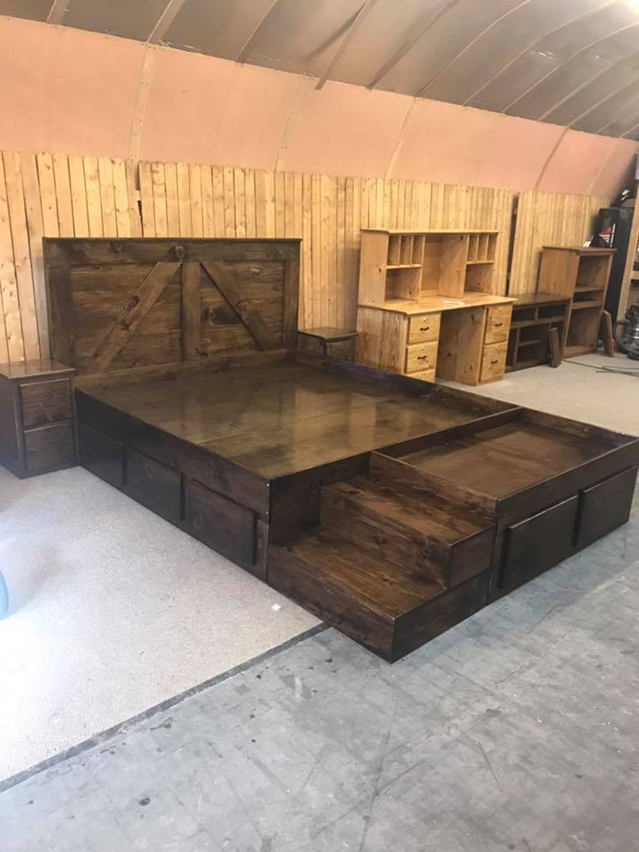 wooden king bed with dog bed and nighstands in dark walnut