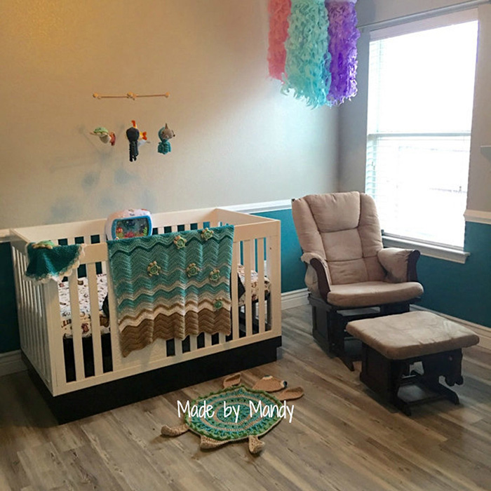 Baby's Room with Crib and Lounge Chair