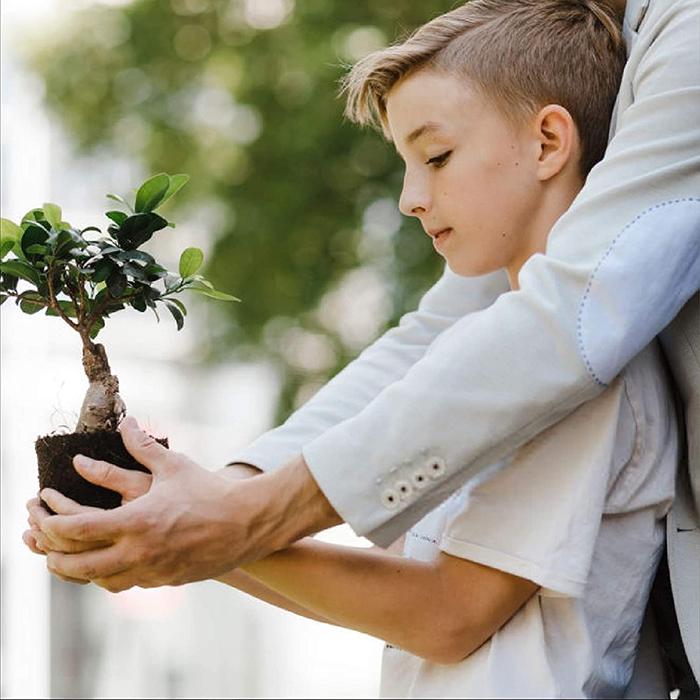 Boy Holding a Small Plant Pot