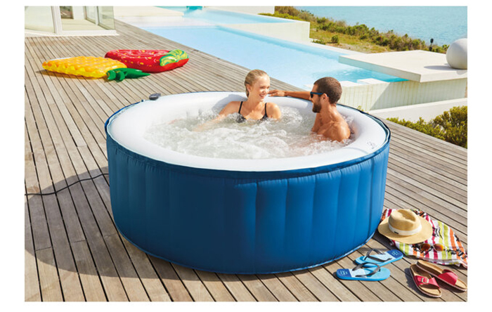 Couple in an Inflatable Tub by the Pool
