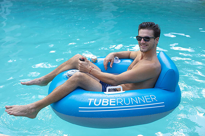 Man Sitting on Motorized Pool Tube