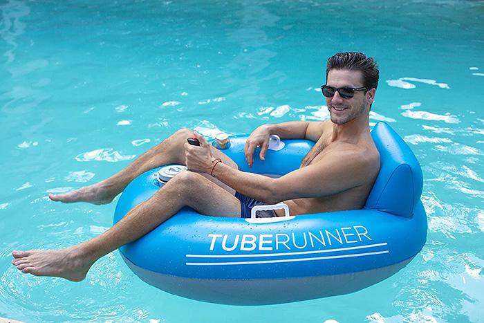 Man Sitting on Motorized Pool Tube