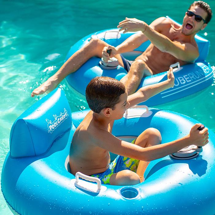 Man and Boy Sitting on Motorized Pool Tubes