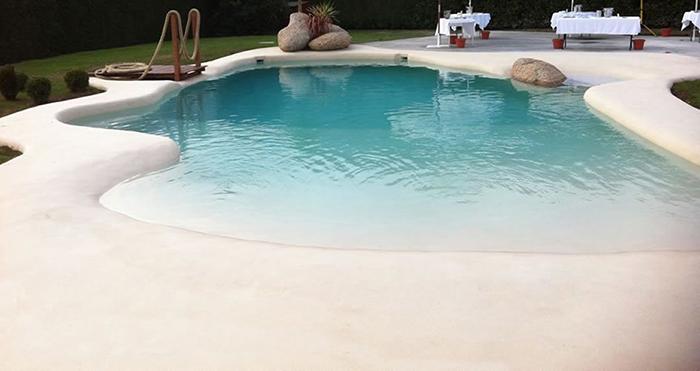 beach-style backyard pool
