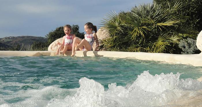 custom pool looks like natural beach