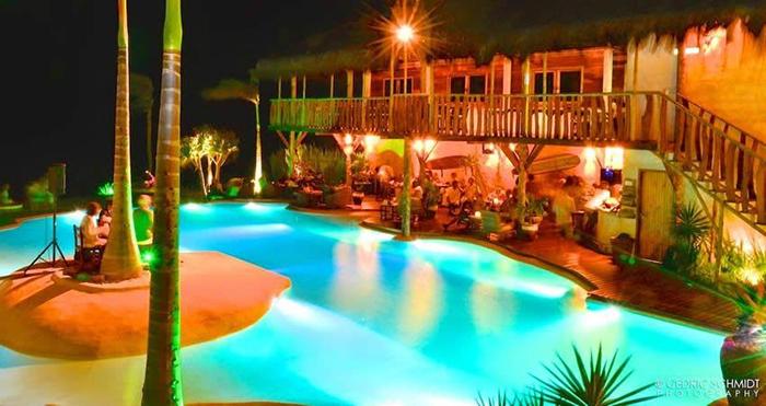 mediterranean style backyard at night