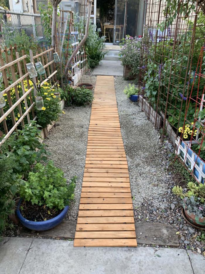 straight hardwood planks garden pathway