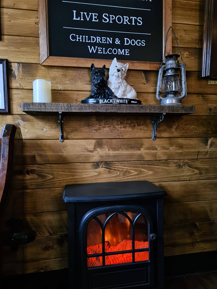 wigan couple mini pub fireplace