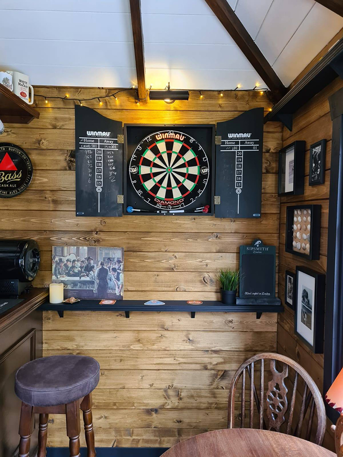 wigan couple mini pub interior dartboard