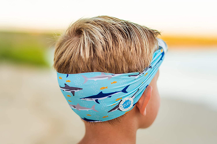 Boy Wearing Swimming Eyewear with Protective Fabric for Hair in Shark Print