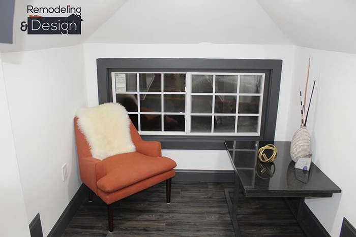 Orange Accent Chair and Black Glass Table by the Window