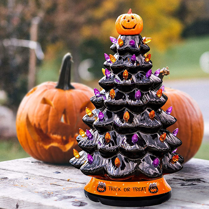 black halloween tree with jack-o-lanterns in the background