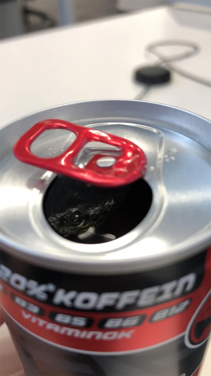 canned drink has crocodile illusion