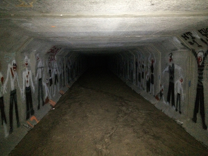 creepy drawings discovered in a tunnel beneath an apartment building