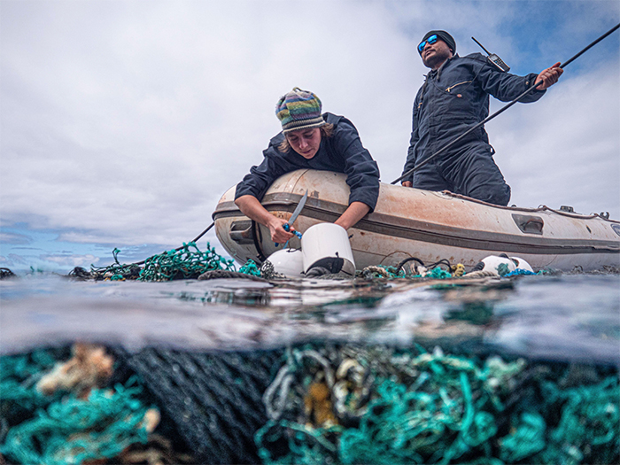 crew removes floating fishing nets
