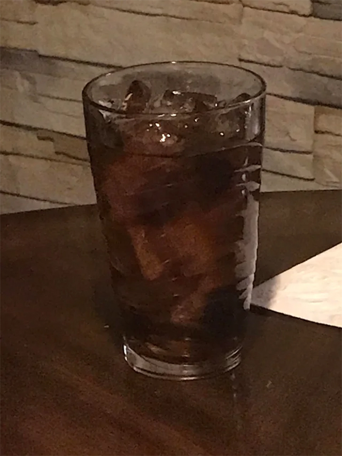 ice in the glass looks like man face