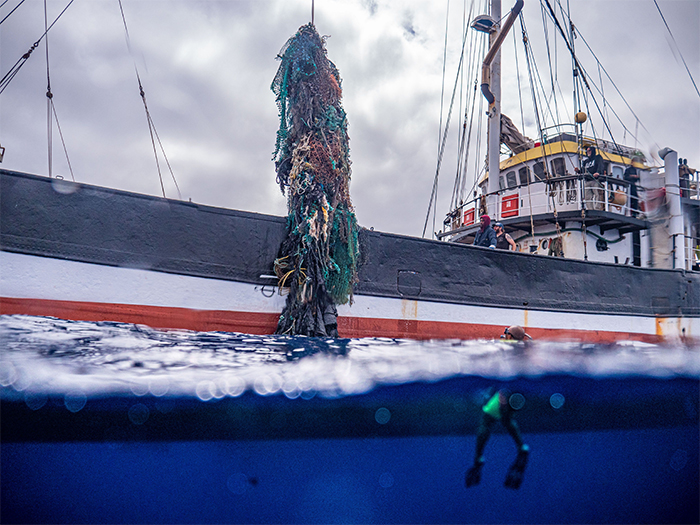 large net lifted by vessel crane