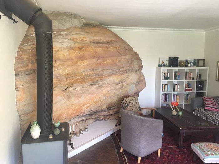 living room built around a huge sandstone rock