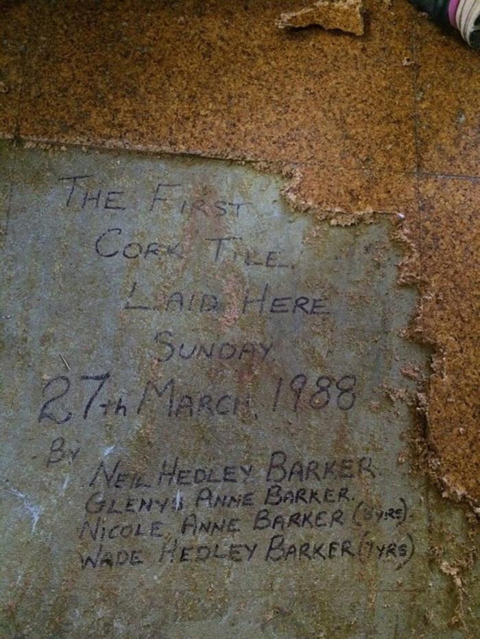 message discovered under cork floor tiles