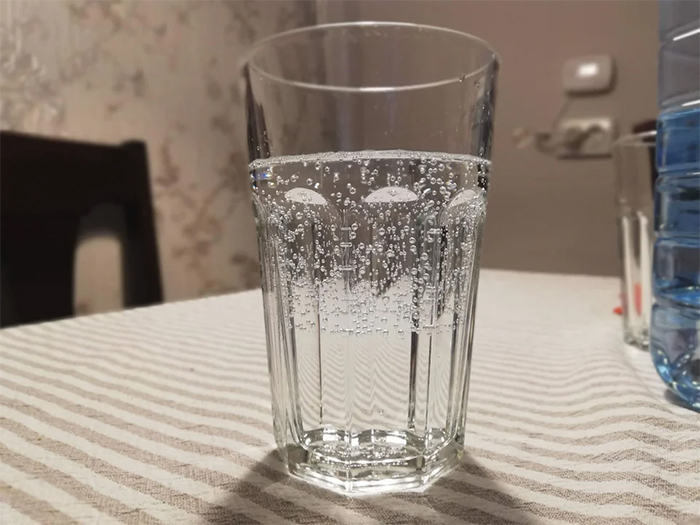 sparkling water poured over tap water