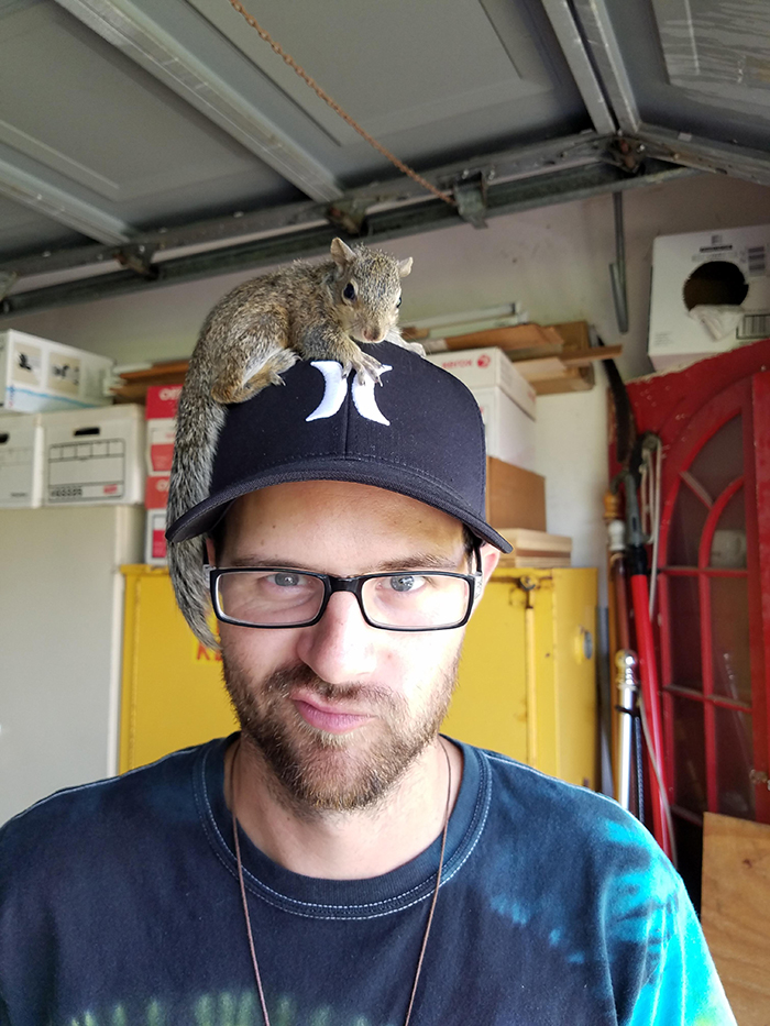 squirrel on a man's head