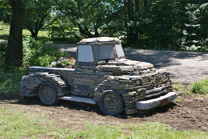 vintage pickup truck made of rocks