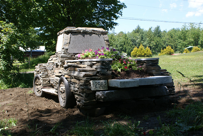 vintage truck sculpture using rocks