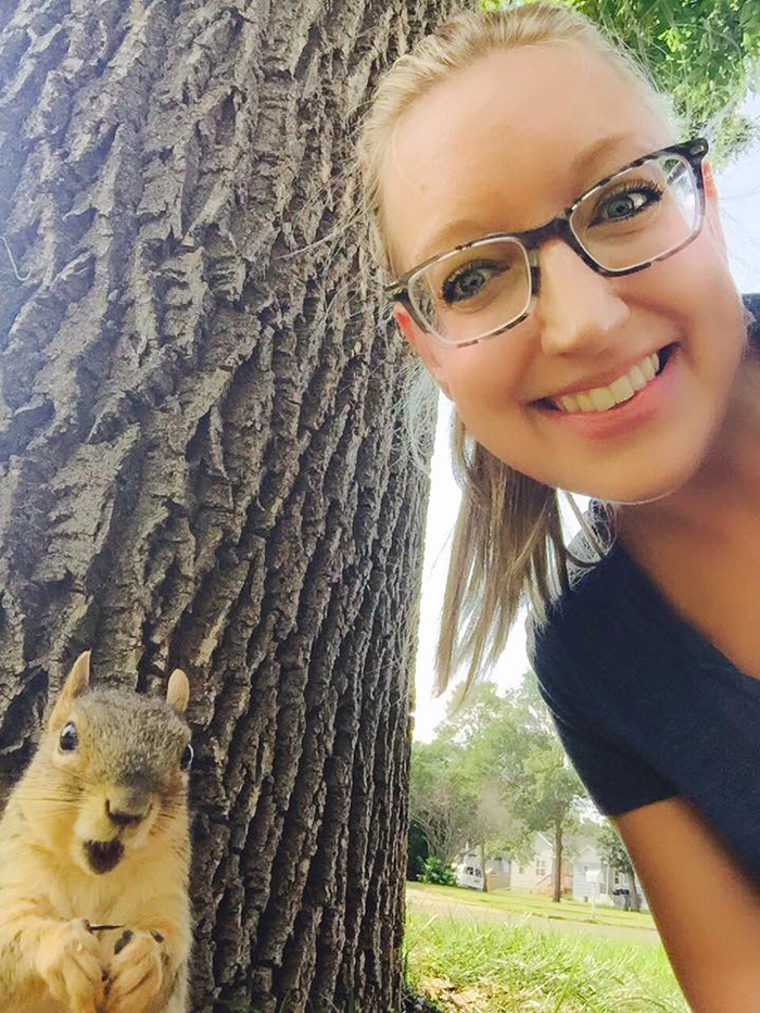 woman taking a selfie with squirrel