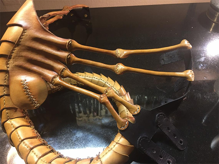alien-inspired face covering leather replica