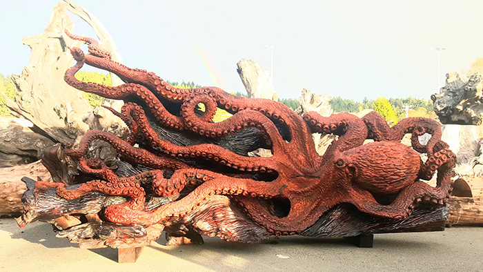 giant octopus carving out of dead redwood tree